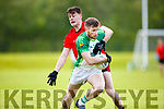Paul Kennelly Ballylongford is tackled by Dan O'Keeffe in Fossa on Saturday evening