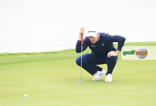 Stephen Gallacher (SCO) on the 13th green during Sunday's Final Round of the 2014 BMW Masters held at Lake Malaren, Shanghai, China. 2nd November 2014.<br /> Picture: Eoin Clarke www.golffile.ie