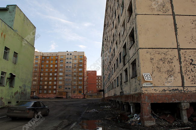 The apartment block on the right has been abandoned because pollution has thawed the permafrost layer it was built on causing the foundation to become unstable. A common problem in Norilsk, Russia, June 15, 2007