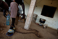 "Mario, 20 years old, former Quiza ( a mixture of cocaine and other drugs, smoked like crack ) addict, lives now at ""Desafio Jovem"" a rehabilitation community in the outskirts of Bissau, Guinea Bissau on Sunday Sept 16 2007. He lives chained to a column, no one would explain why.///.Guinea Bissau is infamous for its cocaine trafficking. in 2005 Colombian cartels begun to arrive in the country transforming it into a Narco State. Up to 5 tons of pure cocaine are estimated to be arriving in the country every week. Guinea Bissau is the 5th poorest country in the world, making it the ideal transit base for the cocaine that will finish on the european markets. Corruption and involvement in the trafficking are present at every level of its institutions..Guinea Bissau is only one of the countries in West Africa involved in cocaine trafficking. Tons of Cocaine have been seized in Nigeria, Senegal, Ghana and  Sierra Leone."