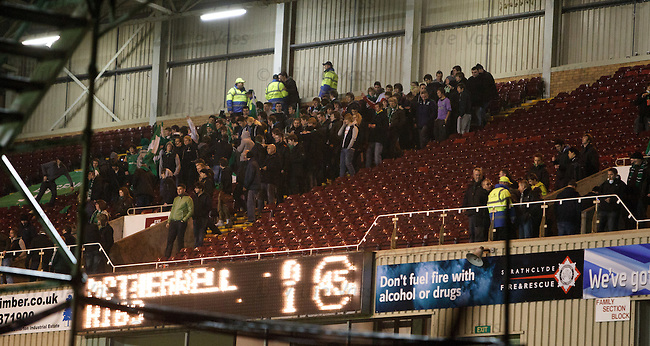 Hibs fans evacuate the away stand at half-time