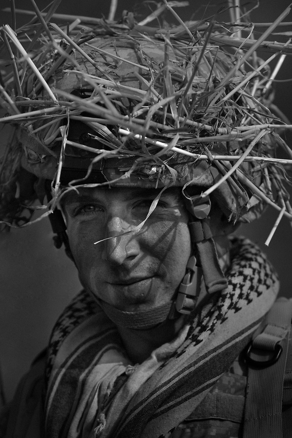A sniper from Headquarters Co. 1-30 Infantry 3rd Infantry Division during an air assault insertion by helicopters into a village south of Baghdad in the Arab Jabour area.