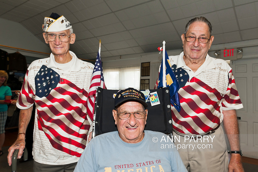Veterans, including Pearl Harbor survivor Bill Halleran (standing at left), at Merrick Post #1282 of American Legion barbecue hosted for Veterans from New York State Nursing Home at Stony Brook NY, in Merrick, New York, USA, on August, 13, 2011. American Legion vetearns standing wearing shirts with big American flag on them, and WWII Veteran in middle is wheelchair decorated with American flags. NOTE: EDITORIAL USE ONLY. RESTRICTIONS also include image is NOT for use for Sensitive Issues, Nor Religious issues, nor Political Issues.