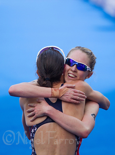 24 AUG 2013 - STOCKHOLM, SWE - Non Stanford (GBR) (right) of Great Britain congratulates race winner Gwen Jorgensen (USA) (left) of the USA at the elite women's ITU 2013 World Triathlon Series round in Gamla Stan in Stockholm, Sweden (PHOTO COPYRIGHT © 2013 NIGEL FARROW, ALL RIGHTS RESERVED)