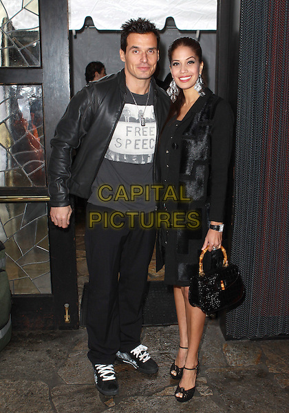 "ANTONIO SABATO JR. & CHERYL MOANA MARIE.Second Annual Valentine Romance ""Sneak Peak"" Oscar Suite held at  Cafe La Boheme, West Hollywood, CA, USA..February 9th, 2010.full length black leather jacket grey gray dress bag purse couple .CAP/ADM/TC.©T. Conrad/AdMedia/Capital Pictures."
