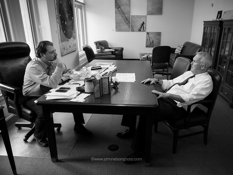 Councilmember Tommy Wells meets with councilmember David Grosso at the Wilson Building in Washington, DC.