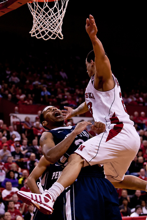 11 January 2012: Bo Spencer #23 of the Nebraska Cornhuskers gets fouled by Tim Frazier #23 of the Penn State Nittany Lions during the second half at the Devaney Sports Center in Lincoln, Nebraska. Nebraska defeated Penn State 70 to 58.