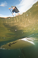 Splash zone underwater photography of stand up paddling on a Boardworks Surf Rusty stand up paddleboard.