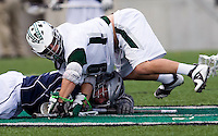 John Schiavone (39) of Loyola fights for the ball on the face off with Brian Tabb (25) of Georgetown at the Ridley Athletic Complex in Baltimore, MD.  Loyola defeated Georgetown, 11-6.