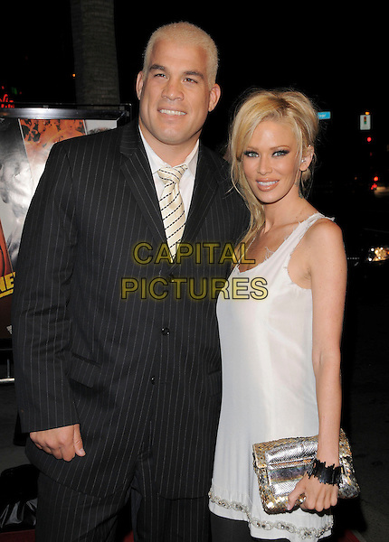"TITO ORTIZ & JENNA JAMESON.Attends The Summit Entertainment Premiere of ""Never Back Down"" held at The Arclight in Hollywood, California, USA,  March 04 2008.                                                                                  half length black pinstripe suit white dress black leggings couple.CAP/DVS.??Debbie VanStory/Capital Pictures"