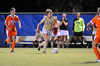 21 August 2011:  FIU's Nikki Rios (4) moves the ball upfield while being pursued by Florida's Jo Dragotta (14) in the second half as the University of Florida Gators defeated the FIU Golden Panthers, 2-0, at University Park Stadium in Miami, Florida.