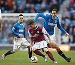 Arbroath's Bobby Linn turns past Rangers defender Bilel Mohsni