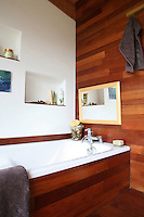 Both the walls of this bathroom and the bath itself are clad in an exotic Asian hardwood which is water resistant