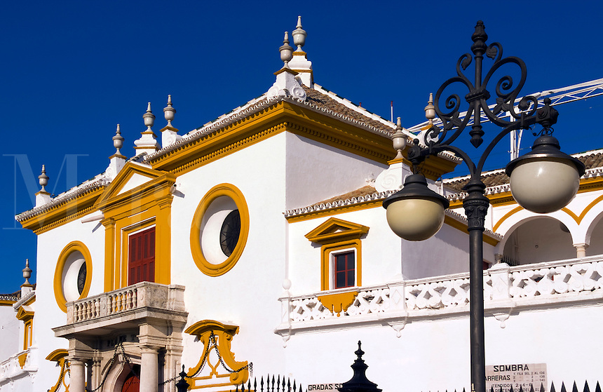 Colorful Plaza de Toros de la Maestranza, bull ring with horse carriage in downtown city of Seville, Sevilla, Spain