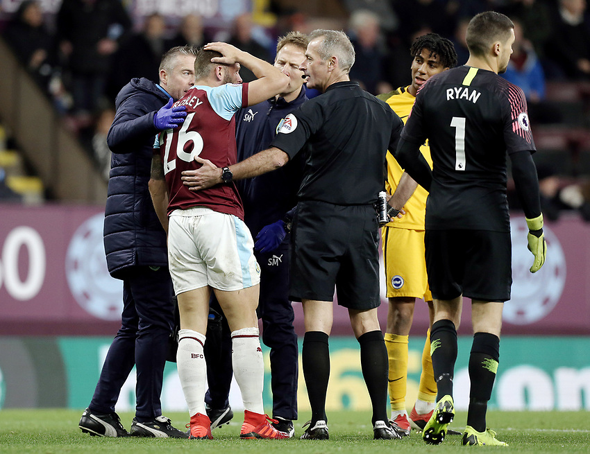 Burnley's Phillip Bardsley remonstrates to Referee Martin Atkinson after he went down with an apparent head injury in the penalty area<br /> <br /> Photographer Rich Linley/CameraSport<br /> <br /> The Premier League - Burnley v Brighton and Hove Albion - Saturday 8th December 2018 - Turf Moor - Burnley<br /> <br /> World Copyright © 2018 CameraSport. All rights reserved. 43 Linden Ave. Countesthorpe. Leicester. England. LE8 5PG - Tel: +44 (0) 116 277 4147 - admin@camerasport.com - www.camerasport.com