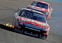 Nov. 9, 2008; Avondale, AZ, USA; NASCAR Sprint Cup Series driver Carl Edwards (99) leads Reed Sorenson during the Checker Auto Parts 500 at Phoenix International Raceway. Mandatory Credit: Mark J. Rebilas-