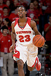 MADISON, WI - NOVEMBER 8: Guard Kammron Taylor #23 of the Wisconsin Badgers handles the ball against the Carroll College Pioneers at the Kohl Center on November 8, 2006 in Madison, Wisconsin. The Badgers beat the Pioneers 81-61. (Photo by David Stluka)