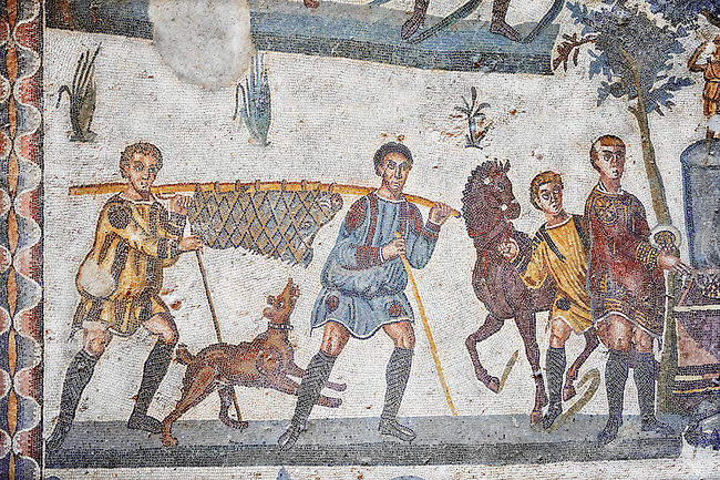 Hunter with a wild boar slung in a net from the Room of The Small Hunt, no 25 - Roman mosaics at the Villa Romana del Casale which containis the richest, largest and most complex collection of Roman mosaics in the world, circa the first quarter of the 4th century AD. Sicily, Italy. A UNESCO World Heritage Site.