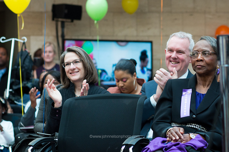 Councilmember Tommy Wells and his wife, Barbara, applaud the new families at Adoption Day in Court at Moultre Courthouse in Washington, DC.