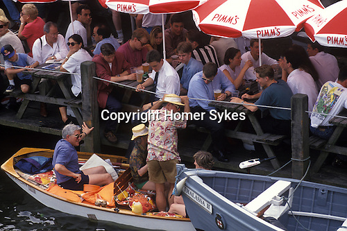 The English summer social season. Enjoying a drink at the annual Henley Royal Rowing Regatta. Henley on Thames, Berkshire, England