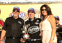 Mar. 13, 2011; Gainesville, FL, USA; NHRA top fuel dragster driver Del Worsham (center), team owner Allan Johnson (left) and wife Connie Worsham celebrate after winning the Gatornationals at Gainesville Raceway. Mandatory Credit: Mark J. Rebilas-