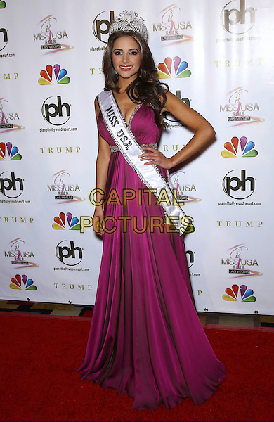 Olivia Culpo.press conference to introduce the 2012 Miss USA (formerly Miss Rhode Island) at Planet Hollywood Resort and Casino, Las Vegas, Nevada, USA..3rd June 2012.full length pink dress crown sash hand on hip cleavage .CAP/ADM/MJT.© MJT/AdMedia/Capital Pictures.