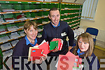 Postal workers Mary Byrne, Michael Wall and Helen O'Callaghan in the Tralee sorting office with some of the thousands of letters to Santa from Kerry Children.