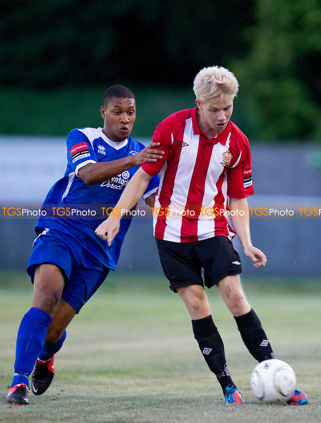 Alex Bentley of Hornchurch plays the ball forward under pressure  - AFC Hornchurch vs Bury Town - Ryman League Premier Division Football at the Stadium, Bridge Avenue - 20/08/13 - MANDATORY CREDIT: Ray Lawrence/TGSPHOTO - Self billing applies where appropriate - 0845 094 6026 - contact@tgsphoto.co.uk - NO UNPAID USE