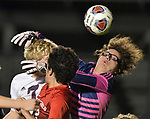Springfield goalkeeper Collin Taylor (right) grabs at the ball and wraps his arms around Gibault's Tate Schilling. In front of Schilling is Springfield's Laith Abdullh. Gibault High School defeated Springfield HS 2-0 in the Class 2A Soccer Sectional at Chatham on Tuesday October 30, 2018 and advance to the state tournament. <br /> Tim Vizer/Special to STLhighschoolsports.com