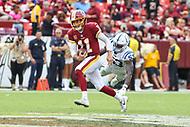 Landover, MD - September 16, 2018: Washington Redskins quarterback Alex Smith (11) avoids Indianapolis Colts linebacker Darius Leonard (53) tackle during the  game between Indianapolis Colts and Washington Redskins at FedEx Field in Landover, MD.   (Photo by Elliott Brown/Media Images International)