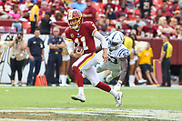 Landover, MD - September 16, 2018: Washington Redskins quarterback Alex Smith (11) avoids Indianapolis Colts linebacker Darius Leonard (53) tackle during the  game between Indianapolis Colts and Washington Redskins at FedEx Field in Landover, MD.   (Photo by Elliott Brown/Media Images International)
