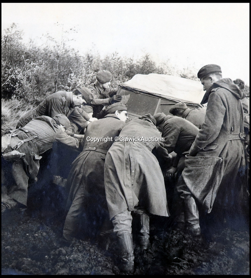 BNPS.co.uk (01202 558833)<br /> Pic:  ChiswickAuctions/BNPS<br /> <br /> Allies helping to rescue a stranded vehicle.<br /> <br /> Remarkable previously unseen photos documenting the momentous closing stages of World War Two and its historic aftermath have come to light.<br /> <br /> They were taken by Sergeant Charles Hewitt, of the Army Film and Photographic Unit, who later went on to work for the Picture Post and the BBC.<br /> <br /> He was present at many of the important offensives of 1944 and '45 including the Battle of Monte Cassino during the Italian Campaign and the Allies advance into Germany following the D-Day invasion.