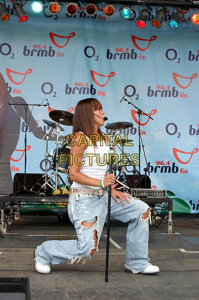 LIBERTY X - JESSICA TAYLOR.Performs live at BRMB's Party In The Park, .Cannon Hill Park, Birmingham, .July 3rd 2005..full length concert gig white vest top cane ripped jeans holes kneeling bending kness.Ref: JEZ.www.capitalpictures.com.sales@capitalpictures.com.©Jez Self/Capital Pictures