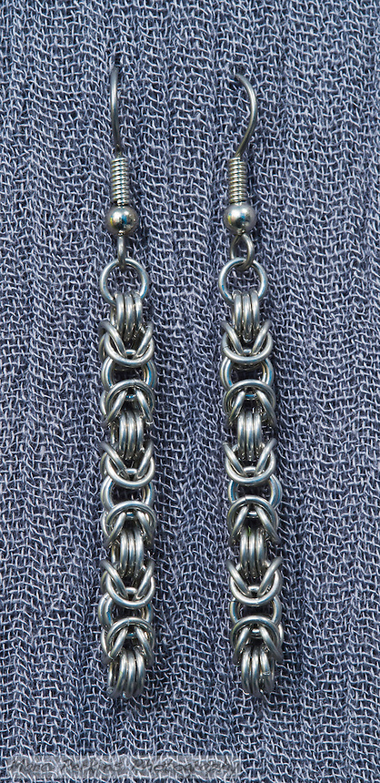 "A pair of chainmail earrings made from anodized 20 gauge 1/8"" bright aluminum rings woven in a byzantine pattern.  Made by Michelle."