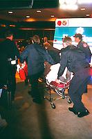 Paramedics loading car crash victim into ambulance.  St Paul Minnesota USA