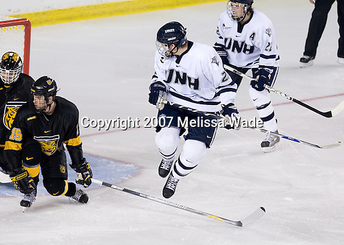 Nate Prosser (CC - 15), James van Riemsdyk (UNH - 21) - The University of New Hampshire Wildcats defeated the Colorado College Tigers 4-2 on Saturday, October 27, 2007, at the Whittemore Center in Durham, New Hampshire.