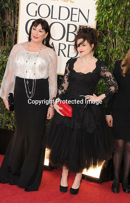 BEVERLY HILLS, CA - JANUARY 13: Anjelica Huston and Helena Bonham Carter arrive at the 70th Annual Golden Globe Awards held at The Beverly Hilton Hotel on January 13, 2013 in Beverly Hills, California.