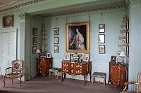 A portrait of Queen Henrietta Maria, Queen Consort of Charles I, from the studio of van Dyke, hangs in the morning room
