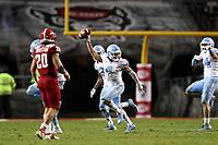 RALEIGH, NC - NOVEMBER 30: Trey Morrison #4 of the University of North Carolina celebrates intercepting the ball during a game between North Carolina and North Carolina State at Carter-Finley Stadium on November 30, 2019 in Raleigh, North Carolina.