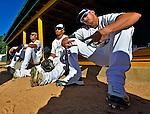 8 July 2012: Members of the Vermont Lake Monsters wait in the dugout for the start of play against the State College Spikes at Centennial Field in Burlington, Vermont. The Lake Monsters rallied from a 2-0 late inning deficit, to defeat the Spikes 8-2 in NY Penn League action. Mandatory Credit: Ed Wolfstein Photo