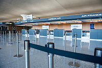 The morning hours are quiet at the international terminal at Dulles International Airport in Dulles, Va., Monday, March16, 2020. Some people are taking the precaution of wearing face masks as they arrive to be greeted by family and or friends. Credit: Rod Lamkey / CNP/AdMedia