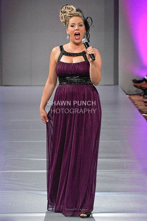 Soprano singer Christine Reber, performs in the Andres Aquino Spring 2012 fashion show, during Couture Fashion Week Spring 2012 at the Waldorf Astoria Hotel in New York City.