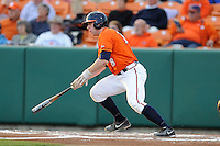 Virginia Cavaliers catcher Nate Irving #18 swings at a pitch  during a game against the Clemson Tigers at Doug Kingsmore Stadium on March 15, 2013 in Clemson, South Carolina. The Cavaliers won 6-5.(Tony Farlow/Four Seam Images).