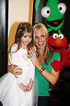 As The World Turns' Terri Colombino and daughter Julia with Elmo and Dorsel at the opening night of John Tartaglia's Imaginocean, a new family undersea musical adventure on March 31, 2010 at New World Stages, New York City, New York. John Tartaglia's ImaginOcean is an interactive family show - a magical, musical undersea adventure for kids of all ages. Tank, Bubbles, and Dorsel are three best friends who just happen to be fish, and they're about to set out on a remarkable journey of discovery. And it all starts with a treasure map. As they swim off in search of clues, they'll sing, they'll dance, and they'll make new friends -- including everyone in the audience. Ultimately, they discover the greatest treasure of all -- friendship. Jam-packed with original music ranging from swing to R&B to Big Band, John Tartaglia's ImaginOcean is a blast rom the first big splash to the last wave goodbye. (Photo by Sue Coflin/Max Photos)