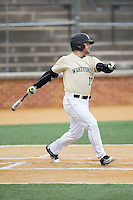 Nate Mondou (10) of the Wake Forest Demon Deacons follows through on his swing against the Harvard Crimson at David F. Couch Ballpark on March 5, 2016 in Winston-Salem, North Carolina.  The Crimson defeated the Demon Deacons 6-3.  (Brian Westerholt/Four Seam Images)