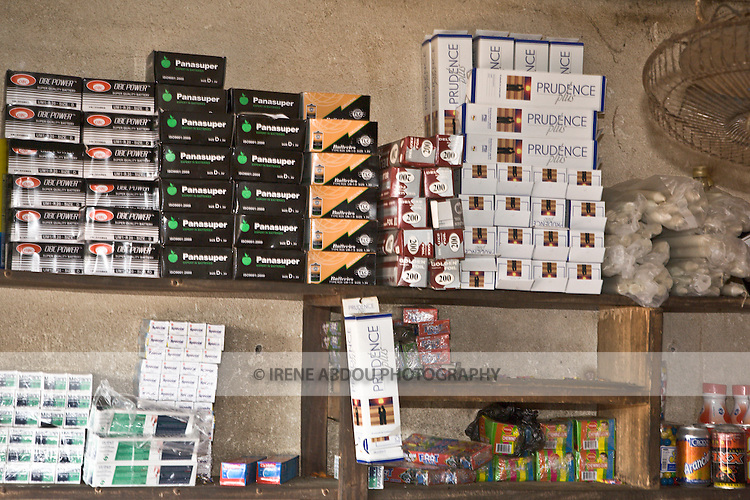 A wholesaler in Conakry, Guinea, displays stacks of Prudence Plus condoms on the shelves.  Prudence Plus is distributed by the international social marketing organization, Popualtion Services International.