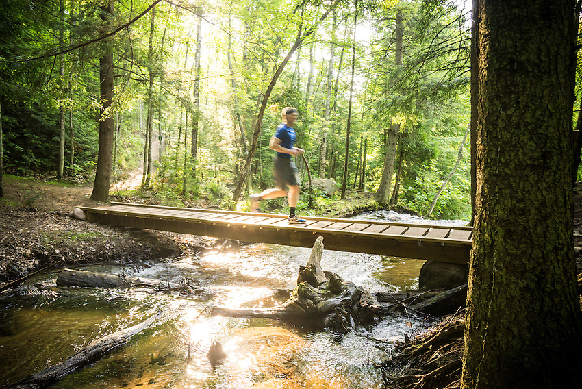 Runners participate in the half-marathon trail run event during Marquette Trails Fest.