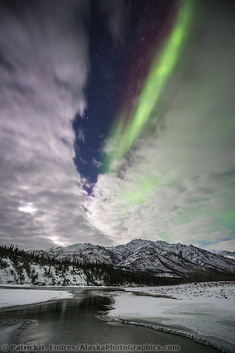 Northern lights reflect in the Koyukuk River, Brooks Range, Alaska.