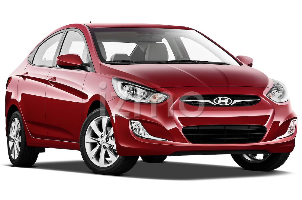 Low aggressive passenger side front three quarter view of a 2012 Hyundai Accent GLS Sedan .