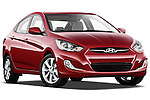 Low aggressive passenger side front three quarter view of a 2012 Hyundai Accent GLS Sedan .